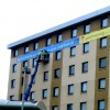 large format vinyl banner being installed on side of hotel