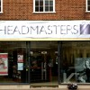 vinyl banners applied to the fascia of a shopfront